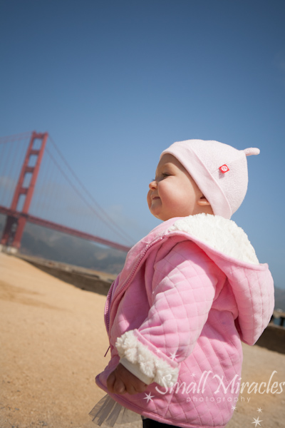 Golden Gate Bridge and baby in pink