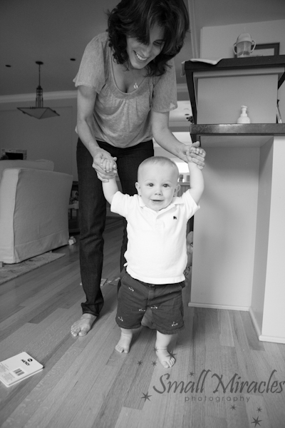 1 year old boy learning to walk