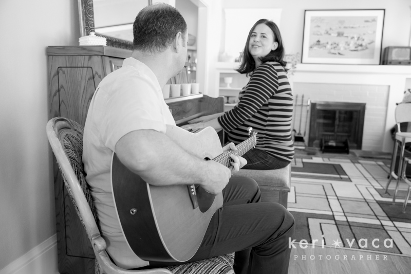 pregnant woman playing piano during maternity photo session