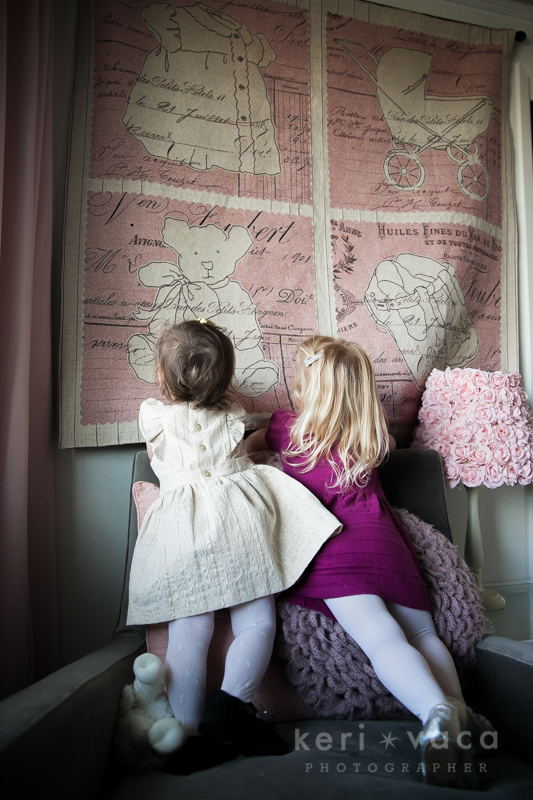 Sisters looking at quilt hanging on their wall