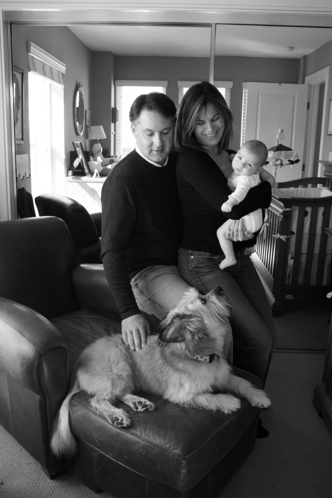 newborn baby and the family with dog