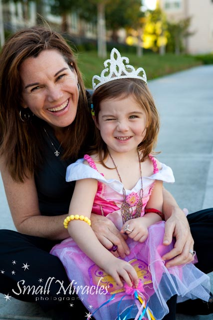 little girls dressed in princess clothes for family photo shoot